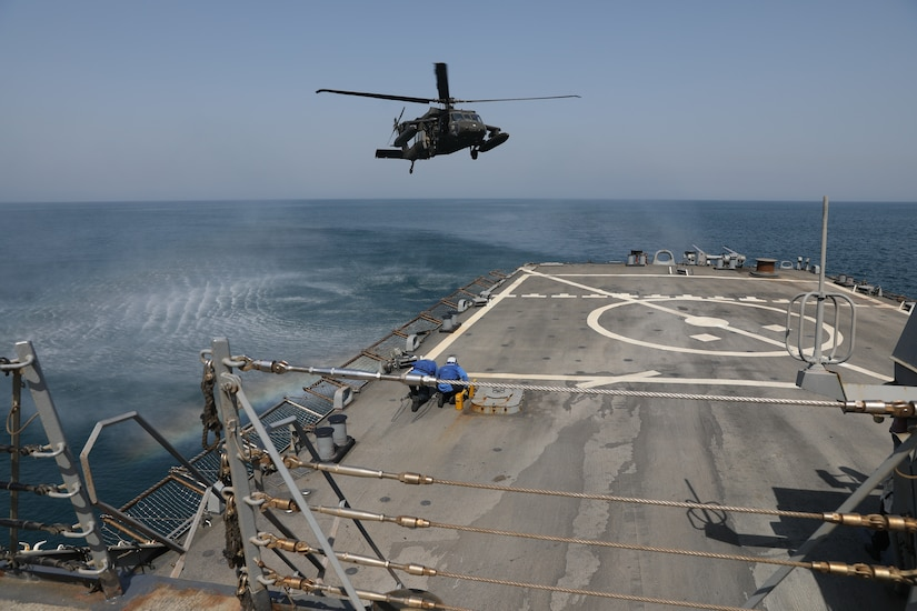 U.S. Navy Sailors aboard the Arleigh Burke-class guided-missile destroyer USS Gonzalez (DDG 66), wait to secure a U.S. Army UH-60 Black Hawk helicopter assigned to Bravo Company, 2nd Battalion, 147th Aviation Regiment currently attached to 8th Battalion, 229th Assault Helicopter Battalion, during deck landing qualifications May 22, 2019 in the Arabian Gulf. The deck landing qualifications where held to increase interoperability between U.S. Army and U.S. Navy personnel.