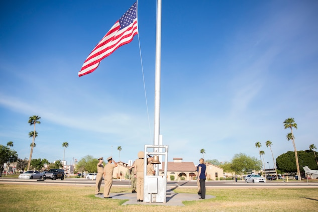 U.S. Navy Chiefs aboard Marine Corps Air Station (MCAS) Yuma observe morning colors on the station's parade deck, April 1, 2019 in celebration of the 126th Birthday of the Chief Petty Officer. The Corpsmen raised the flag at half-staff in honor of Maj. Matthew M. Wiegand and Capt. Travis W. Brannon, the two Marine Corps pilots killed in the AH-1Z Viper Helicopter crash March 30, 2019. (U.S. Marine Corps photo by Cpl. Sabrina Candiaflores)