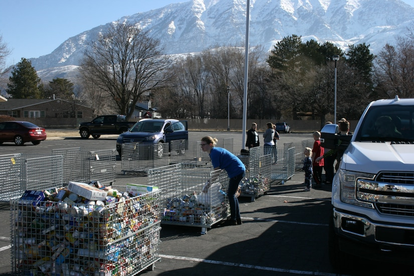Boy Scouts and volunteers unload food at the Community Action Services and Food Bank in Orem, March 16, 2019 during Scouting for Food.