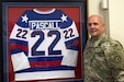 U.S. Army Reserve Col. Patrick M. Pascall, 9th Mission Support Command's operations, plans and training officer, poses with his Olympic Team USA hockey jersey at the Daniel K. Inouye Reserve Complex, Fort Shafter Flats, Honolulu, Hawaii, May 31, 2019. (U.S. Army photo by Staff Sgt. David Overson)
