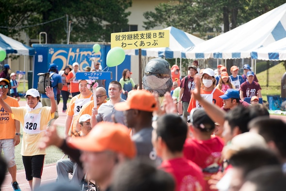 Athletes, their buddies and coaches march in the opening parade of the Kanto Plains Special Olympics at Yokota Air Base, Japan, June 1, 2019