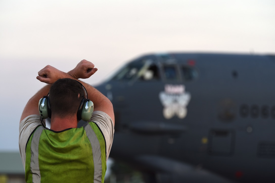 U.S. Air Force Airman 1st Class David Chorjel, 23rd Expeditionary Maintenance Squadron crew chief, signals for the pilots to hold the B-52 Stratofortress in place during Exercise Diamond Storm at RAAF Base Darwin, Australia, May 15, 2019. The B-52s allowed for simulated target strikes to aid in the exercise training efforts. (U.S. Air Force photo by Staff Sgt. Joshua Edwards)