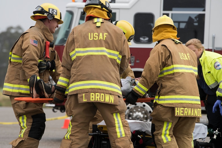 30th Space Wing firefighters carry a victim during a DUI production reenactment during Spring Wingman Day May 23, 2019, at Vandenberg Air Force Base, Calif. In the U.S., over 28 people are killed in drunk-driving crashes and roughly one in three people will be involved in a crash in their lifetimes. (U.S. Air Force photo by Airman 1st Class Hanah Abercrombie)