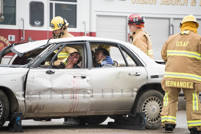 30th Space Wing firefighters arrive on scene during a DUI production reenactment during Spring Wingman Day May 23, 2019, at Vandenberg Air Force Base, Calif. The production highlighted the potential consequences of driving under the influence and the damage it can do to those around you. (U.S. Air Force photo by Airman 1st Class Hanah Abercrombie)