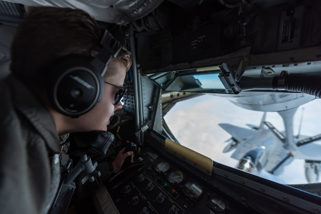 U.S. Air Force Airman 1st Class Brooke Griffin, 909th Air Refueling Squadron boom operator, refuels an F-15C Eagle April 15, 2019, during a routine training exercise out of Kadena Air Base, Japan. The 909th ARS helps ensure a free-and-open Indo-Pacific by providing air refueling to U.S., allies and partners within the area of responsibility. (U.S. Air Force photo by Airman 1st Class Matthew Seefeldt)