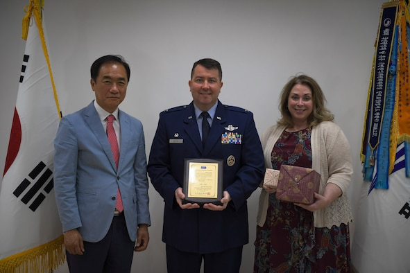 U.S. Air Force Col. William Betts, 51st Fighter Wing commander, accepts an honorary citizenship plaque from Pyeongtaek Mayor Jung Jang-seon in Pyeongtaek, Republic of Korea, May 29, 2019. Jang-seon awarded Betts for his and Osan Air Base's continued support and contributions to the community. (U.S. Air Force photo by Staff Sgt. Greg Nash)