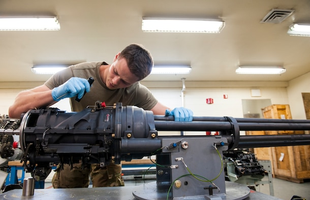 U. S. Air Force Staff Sgt. Joshua Boyd, armament maintenance supervisor assigned to the 18th Equipment Maintenance Squadron, inspects a 20mm Automatic M61A1 at Kadena Air Base, Japan, May 29, 2019.
