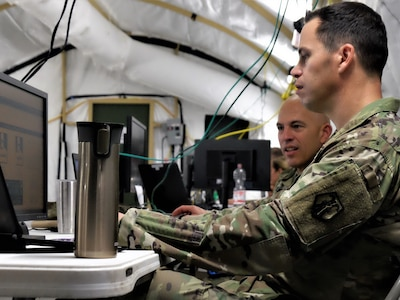 KAISERSLAUTERN, Germany – Maj. Jason M. Ruiz (front), the G3 plans officer, and Lt. Col. Scott A. Silvester, the G3 force modernization officer, both part of the exercise White Cell, develop the exercise scenario in order to test the unit's ability to conduct the military decision making process  during the 7th MSC's Annual Training at Daenner Kaserne May 30 to June 4, 2019. (US Army photo by Sgt. Daniel J. Friedberg, 7th MSC Public Affairs Office)
