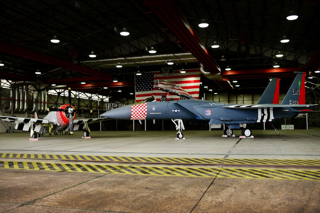 An F-15E Strike Eagle assigned to the 492nd Fighter Squadron is painted in the heritage colors of its World War II P-47 Thunderbolt predecessor at Royal Air Force Lakenheath, England Jan 31. The 48th Fighter Wing officially unveiled the aircraft publicly during a ceremony on Jan 31. (U.S. Air Force photo/Tech. Sgt. Matthew Plew)