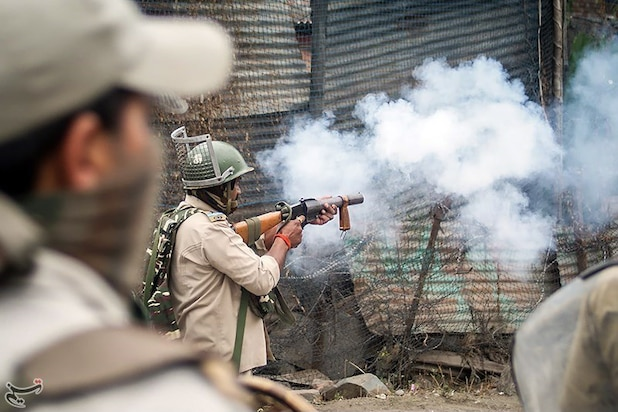 Indian security forces use tear gas and pellet guns to disperse Kashmiri demonstrators.