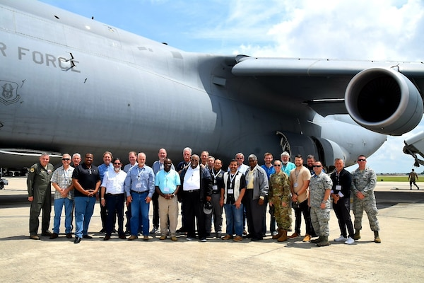 Civilian clergy and their military sponsors pose for a photo in front after a flight on a C-5M Super Galaxy at the 433rd Airlift Wing's annual Clergy Day flight June 1 at Joint Base San Antonio-Lackland. The goal of the program was to give the guests an understanding of the wing's missions, so they could be equipped to minister to the needs of Reservists at their civilian places of worship.