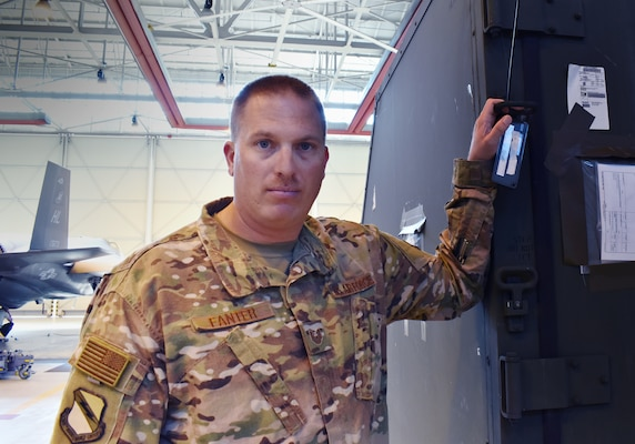 Tech. Sgt. Allen Fanter, the non-commissioned officer in charge of cargo operations for the 388th Maintenance Group, stands next to a cargo container in a hangar at Aviano Air Base, Italy during Astral Knight 2019. Fanter is the man tasked with making sure everything needed for a deployment gets to where it needs to be. This is one of more than a dozen movements Fanter has overseen since the 388th and 419th Fighter Wing's received their first F-35As in 2015. (U.S. Air Force photo by Micah Garbarino)