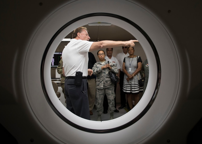 A medical equipment company representative highlights computed tomography scan unit features during the Manpower and Equipment Force Packaging Summit at Joint Base Langley-Eustis, Virginia, June 4, 2019.