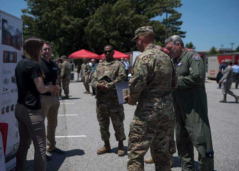 An Expeditionary Preventative Clinic Systems representative speaks to members from various U.S. Air Force major commands during the Manpower and Equipment Force Packaging Summit at Joint Base Langley-Eustis, Virginia, June 4, 2019.