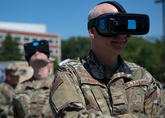 U.S. Air Force Col. James Sampson, Air Force Medical Operations Agency chief medical consultant, views a medical shelter facility with virtual reality goggles during the Manpower and Equipment Force Packaging Summit at Joint Base Langley-Eustis, Virginia, June 4, 2019.
