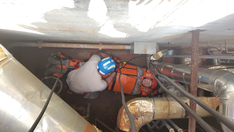 Reserve Citizen Airmen from the 445th Civil Engineer Squadron participate in confined space rescue training during the May 5, 2019, unit training assembly at Wright Patterson Air Force Base, Ohio. The training is designed to prepare CES firefighters to retrieve injured personnel who have become stuck in maintenance tunnels, access ways and similarly confined spaces.