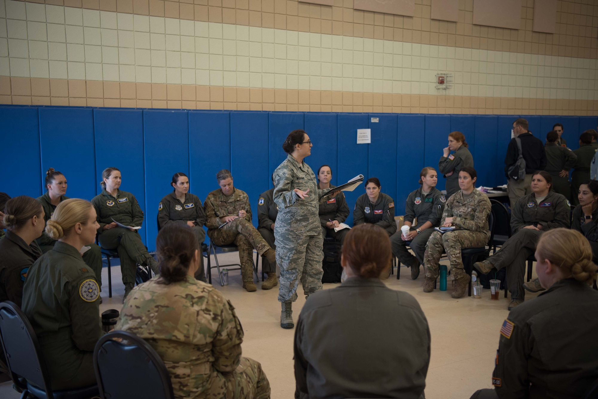 A group of U.S. Air Force and U.S. Navy female aviators have a discussion about some of the improvements they want to see made to their flight equipment during a Female Fitment Event at Joint Base Langley-Eustis, Virginia, June 4, 2019. The event took measurements from female aviators from the U.S. Air Force and the U.S. Navy at various stages in their careers, to get an accurate depiction of the changes needed to flight equipment. (U.S. Air Force photo by Airman 1st Class Marcus M. Bullock)