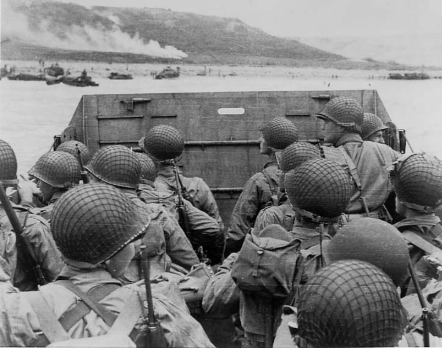 Assault troops in a landing craft approach Normandy beach