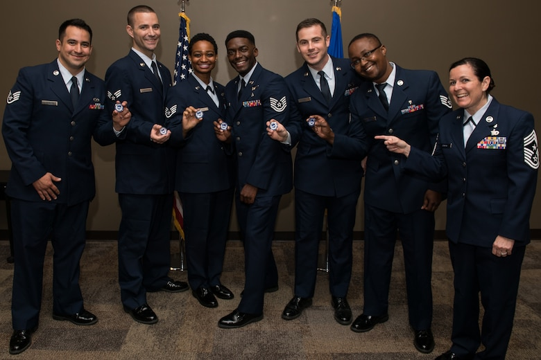 Attending graduates pose with Command Chief Master Sgt. Barbara Gilmore, 932nd Airlift Wing, after receiving their CCAF diplomas and a Wing coin, June 2, 2019, Scott Air Force Base, Illinois. (U.S. Air Force photo by Master Sgt. Christopher Parr)