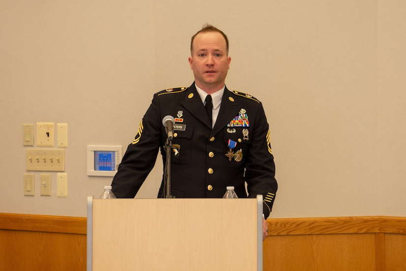 Sgt.1st Class Greg Waters delivers remarks after receiving his award.