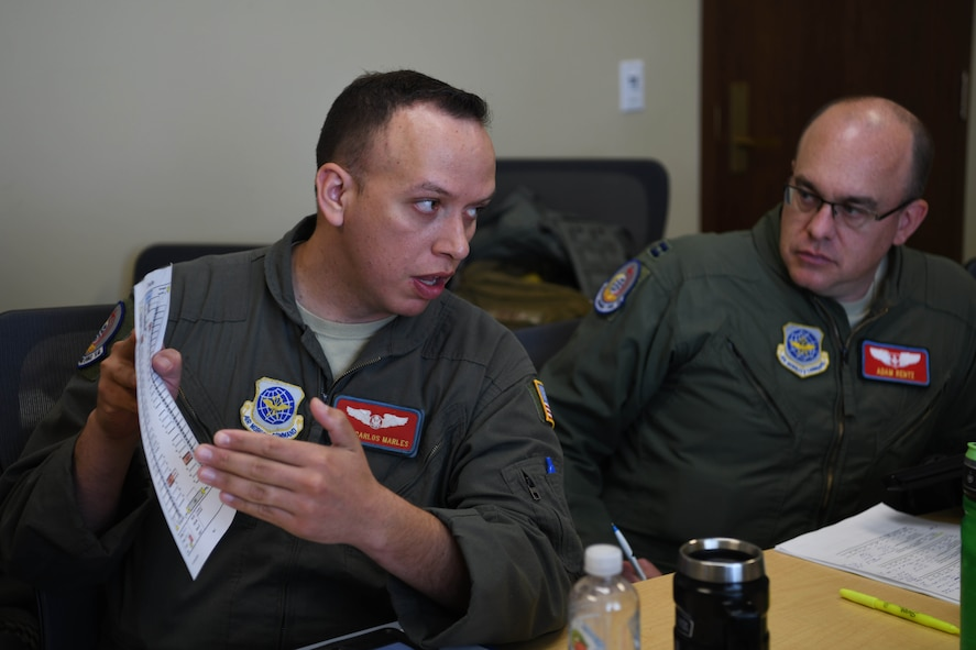 Airman shows information to another person