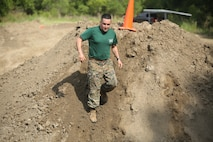 "Staff Sgt. Nicholas Pavez cimbs down a hill during ""Throwdown at Fightertown"" aboard MArine Corps Air Station Beaufort, May 31. Pavez is a drill instructor with support battalion aboard Marine Corps Recruit Depot Parris Island."