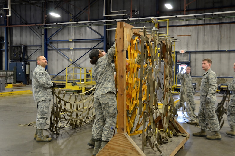 Airmen from the 87th Aerial Port Squadron hang nets after the cargo build up competition during the 87th APS Port Dawg Challenge May 5, 2019. During the May unit training assembly, more than 130 members of the squadron gathered in friendly competition.