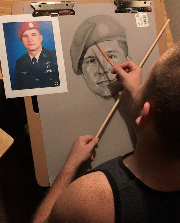 Senior Airman Nathan Towns, 24th Air Force manpower, personnel and services technician, draws a portrait of Master Sgt. John Chapman last November. Towns' portrait was unveiled during a dedication ceremony for Chapman at Pope Army Airfield on May 30, 2019. The drawing took Towns 32 hours to complete. (Courtesy photo)