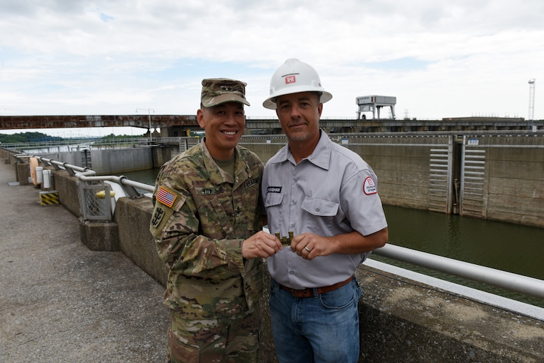 Maj. Gen. Mark Toy (Left), U.S. Army Corps of Engineers Great Lakes and Ohio River Division commander, presents a commander's coin for excellence to Ross Cunningham, lock and dam mechanic, during a visit to Barkley Lock and Dam on the Cumberland River in Grand Rivers, Ky., June 4, 2019. (USACE photo by Lee Roberts)