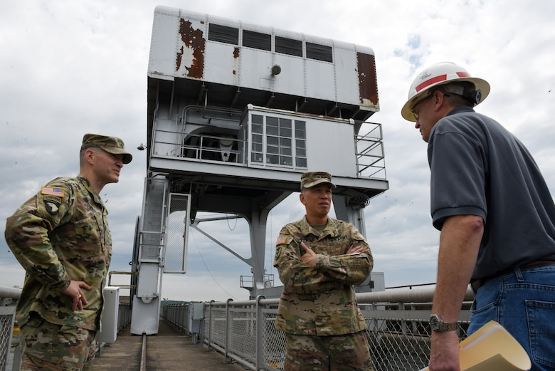 John Tribble (Right), U.S. Army Corps of Engineers Nashville District mechanical engineer, and Lt. Col. Cullen Jones (Left), Nashville District commander, address status of crane repairs at Barkley Dam with Maj. Gen. Mark Toy, Great Lakes and Ohio River Division commander, during a visit to the project on the Cumberland River in Grand Rivers, Ky., June 4, 2019. (USACE photo by Lee Roberts)