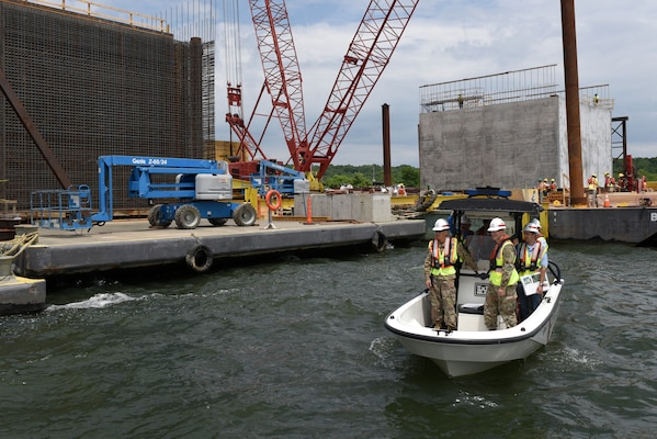 Maj. Gen. Mark Toy, U.S. Army Corps of Engineers Great Lakes and Ohio River Division commander, observes operations to construct concrete shells being assembled on the shoreline of the Tennessee River during a ride in a Corps of Engineers patrol boat at the Kentucky Lock Addition Project in Grand Rivers June 4, 2019.  The shells are being installed to the downstream riverbed for dual use as part of the permanent lock wall and for the coffer dam. (USACE photo by Lee Roberts)