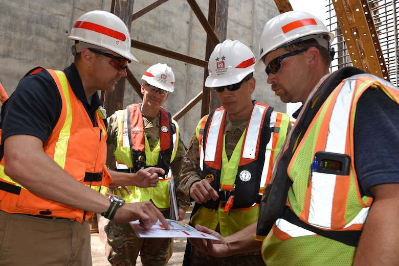 Maj. Gen. Mark Toy (Second from Right), U.S. Army Corps of Engineers Great Lakes and Ohio River Division commander, and Lt. Col. Cullen Jones (Second from Left), Nashville District commander, receive a briefing on the assembly of the concrete shells from Jeremiah Manning, project manager, and Jody Robinson, mechanical engineer, during a visit to the Kentucky Lock Addition Project in Grand Rivers, Ky., June 4, 2019. The shells are being installed to the downstream riverbed for dual use as part of the permanent lock wall and for the coffer dam. (USACE photo by Lee Roberts)
