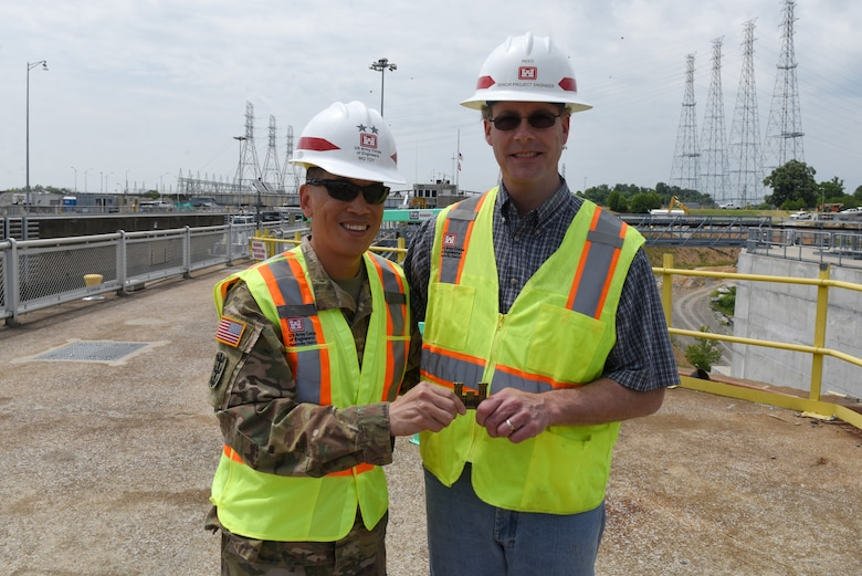 Maj. Gen. Mark Toy (Left), U.S. Army Corps of Engineers Great Lakes and Ohio River Division commander, presents a commander's coin for excellence to John Reed, Kentucky Lock Addition Project senior project engineer, during a visit to Kentucky Lock on the Tennessee River in Grand Rivers, Ky., June 4, 2019. (USACE photo by Lee Roberts)