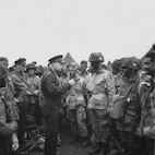 General Dwight D. Eisenhower, the Supreme Allied Commander in charge of all forces involved in the Normandy landing, speaks to paratroopers of the 101st Airborne Division on the eve of D-day, 5 June 1944.