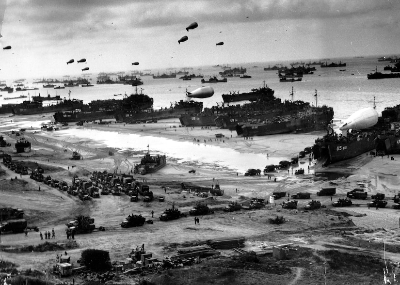 Navy landing ships unload reinforcements, heavy weapons and additional supplies on Omaha Beach in Normandy, France, June 9, 1944.