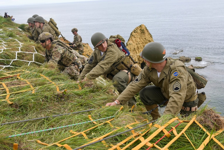 U.S. Army Rangers assigned to the 75th Ranger Regiment climb the cliffs at Pointe du Hoc in Cricqueville en Bessin, France, June 4, 2019. Rangers scaled the cliff to honor the 135 men killed or wounded from the 2nd and 5th Ranger Battalions while capturing and holding Pointe du Hoc. More than 1,300 U.S. service members, partnered with 950 troops from across Europe and Canada, converged in northwestern France to commemorate the 75th anniversary of Operation Overlord, the World War II Allied invasion of Normandy, commonly known as D-Day.
