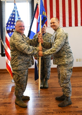 Col. William Boothman takes guidon from Col. Ken Eaves at the 157th Air Operations Group change of command ceremony at Jefferson Barracks Air National Guard Base.