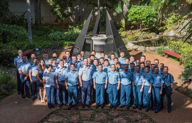 United States Air Force Airmen take a group photo with members of the People's Liberation Army Air Force Command College during a visit to Headquarters Pacific Air Forces at Joint Base Pearl Harbor-Hickam, Hawaii, May 28, 2019.