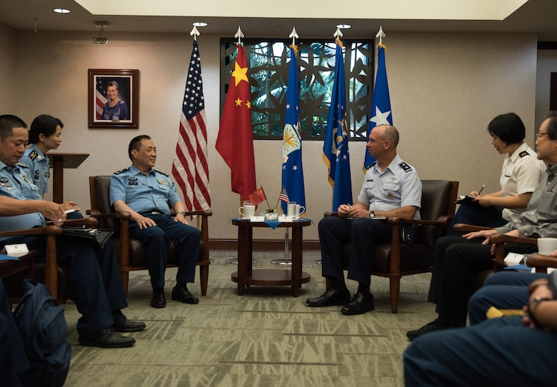 People's Liberation Army Air Force Maj. Gen. An Peng, Command College deputy commandant, and U.S. Air Force Maj. Gen. Brian Killough, Pacific Air Forces deputy commander, have a discussion during an office call at Headquarters Pacific Air Forces at Joint Base Pearl Harbor-Hickam, Hawaii, May 28, 2019.
