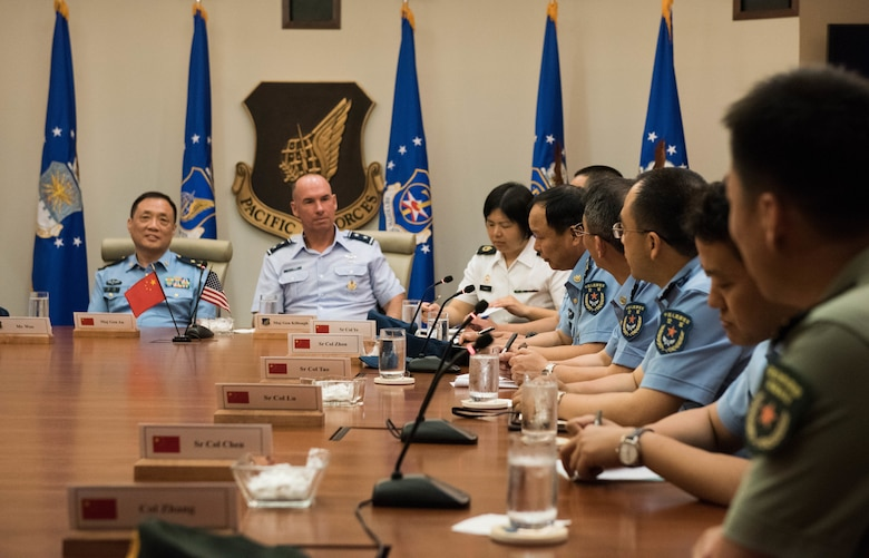 Members of the People's Liberation Army Air Force Command College introduce themselves during a visit to Headquarters Pacific Air Forces at Joint Base Pearl Harbor-Hickam, Hawaii, May 28, 2019. This is a reciprocal visit, following on the visit that members of the U.S. Air War College took to China in March 2019.