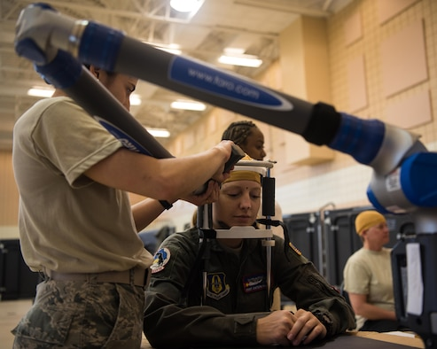 A U.S. Air Force Airman gets her head measured at the Female Fitment Event at Joint Base Langley-Eustis, Virginia, June, 4, 2019. The event allowed female aviators the chance to have their measurements taken and used for the designing of female flight equipment prototypes. (U.S. Air Force photo by Airman 1st Class Marcus M. Bullock)