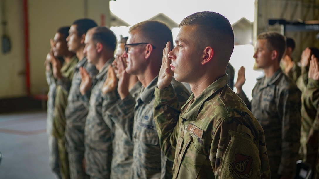 Airmen from the 44th and 67th fighter squadron recite the dedicated crew chief's creed