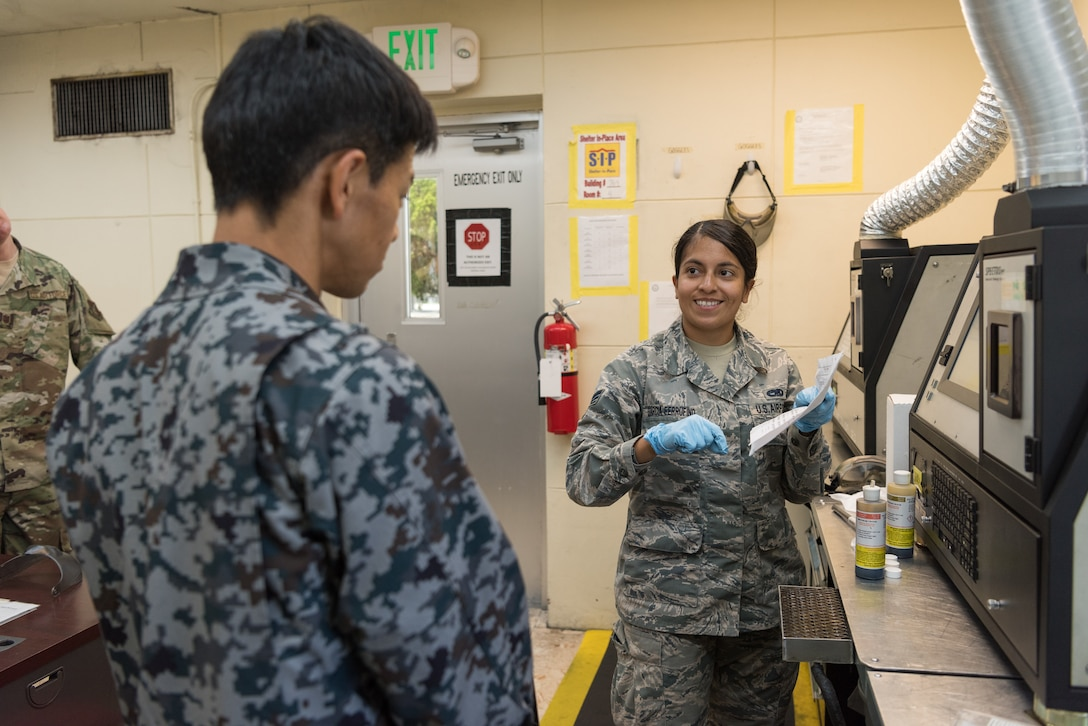 U.S. Air Force Senior Airman Diana Garcia-Ferrufino, nondestructive inspection journeyman assigned to the 18th Equipment Maintenance Squadron, performs a metals check using the joint oil analysis program during a bilateral training exercise with the Japan Air Self-Defense Force May 23, 2019, on Kadena Air Base, Japan. The 18th EMS holds frequent bilateral training exercises with JASDF counterparts to build stronger partnerships and maintain a constant level of readiness. (U.S. Air Force photo by Airman 1st Class Cynthia Belío)