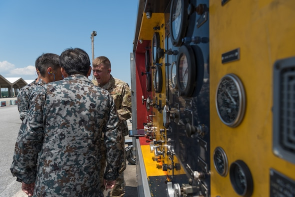 U.S. Air Force Tech. Sgt. Adam Decker, south aerospace ground equipment section chief assigned to the 18th Equipment Maintenance Squadron, demonstrates how to use the hydraulic test stand during a bilateral training exercise with the Japan Air Self-Defense Force May 23, 2019, on Kadena Air Base, Japan. This bilateral training exercise focused on teaching JASDF members the functions and purpose of aerospace ground equipment and nondestructive inspection flights. (U.S. Air Force photo by Airman 1st Class Cynthia Belío)