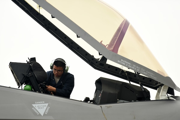 Senior Airman Shawn Pham, 421st Aircraft Maintenance Unit crew chief, inspects an F-35A Lightning II fighter jet during Astral Knight 2019 on June 5, 2019, at Aviano Air Base, Italy. The F-35A is the U.S. Air Force's latest fifth-generation fighter that complements the air superiority of other fourth and fifth-generation aircrafts. (U.S. Air Force photo by Tech. Sgt. Jim Araos)