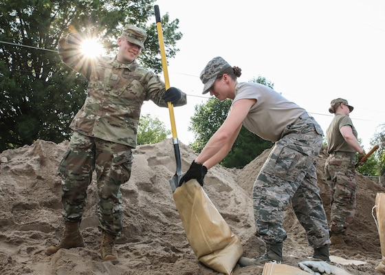 Citizen-Airmen from the Missouri Air National Guard's 131st Bomb Wing, headquartered at Whiteman Air Force Base, and 139th Airlift Wing, headquartered at Rosecrans Air National Guard Base, near St. Joseph, fill sandbags at Norborne High School, Missouri, June 1, 2019. Approximately 100 Airmen were part of a flood response effort ordered by Missouri Gov. Mike Parson.