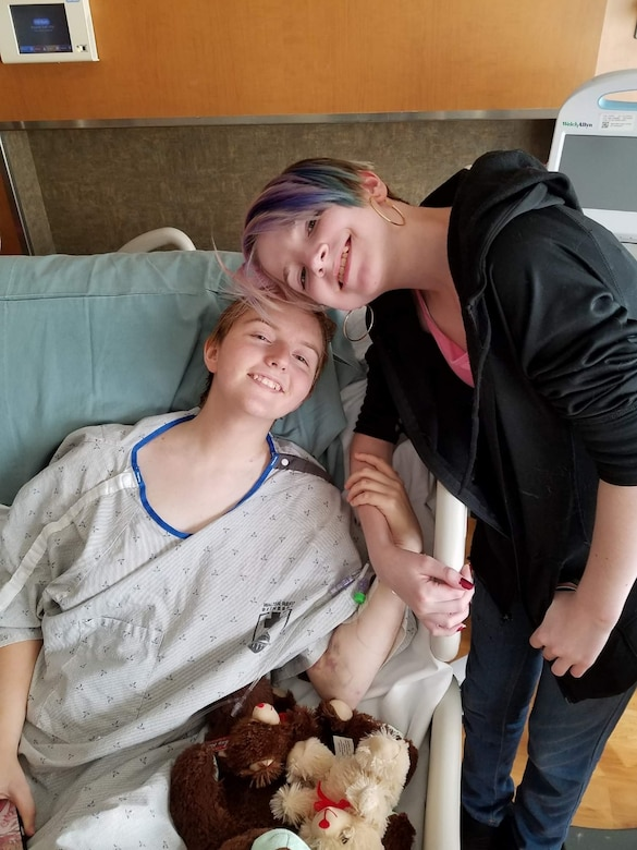 U.S. Air Force Airman 1st Class Constance Bratcher takes a photo with her cousin while in the hospital around May 2018.