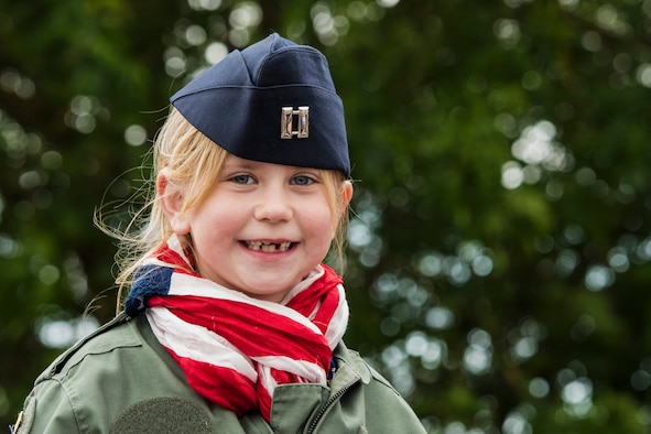 A French child smiles for a photo following the conclusion of a ceremony held in honor of all airborne troops and flight crew that served on D-Day in Picauville, France, June 4, 2019. The ceremony's guest speaker, U.S. Air Force Maj. Gen. John B. Williams, United States Air Forces in Europe and Air Forces Africa mobilization assistant to the commander, said how real the memories of D-Day are for families living in Normandy, France, as if it happened yesterday. Williams said it's very gratifying to know the events that transpired 75 years ago will be remembered well into the future in large part because of the French effort to ensure the memories of D-Day remain eternal. (U.S. Air Force photo by Senior Airman Kristof J. Rixmann)