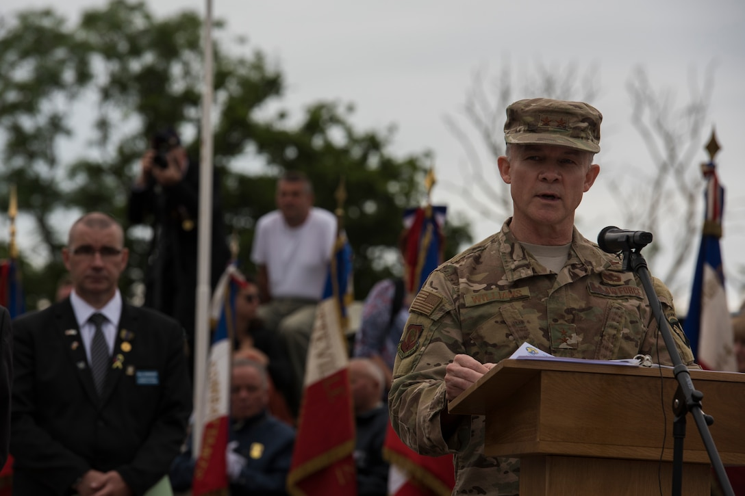 U.S. Air Force Maj. Gen. John B. Williams, United States Air Forces in Europe and Air Forces Africa mobilization assistant to the commander, speaks at a ceremony held in honor of all airborne troops and flight crew that served on D-Day in Picauville, France, June 4, 2019. Williams said seeing the terrain where so many U.S. sacrifices were made is a poignant reminder of the cost of freedom experienced today. (U.S. Air Force photo by Senior Airman Kristof J. Rixmann)