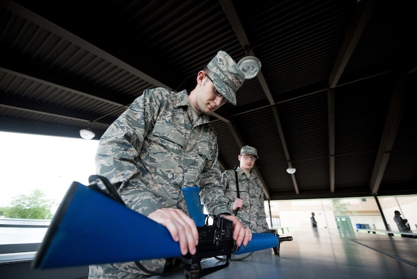 U.S. Air Force basic military training trainees practice assembling and disassembling their M-16 trainer weapon, May 2, 2019, at Joint Base San Antonio-Lackland. Airmen must know how to fix malfunctions in order to continue the fight and protect their fellow Wingman. Basic military training is an eight-week course designed to challenge Airmen mentally and physically. (U.S. Air Force photo by Sarayuth Pinthong)